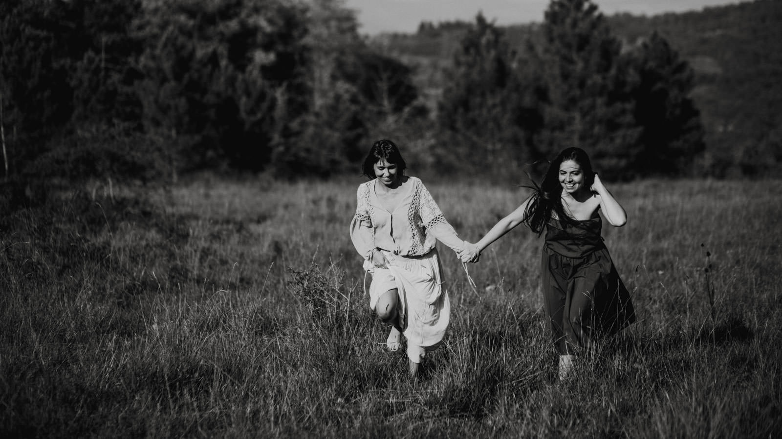 girls running on meadow